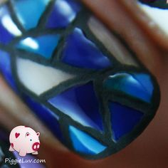 I made stained glass nail art as twin nails with my friend Celestine! I used real ceramic and glass paint and I left the black lines matte because they look more like lead that way.
