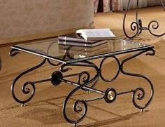 Wrought iron coffee table with coloured glass inserts