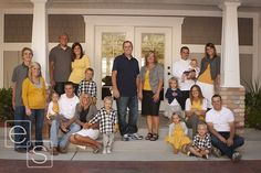 Large family, photo in front of their home, also nicely coordinated clothing