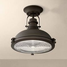 Update your home with this rustic-industrial bronze ceiling light featuring the subtle style boost of ribbed glass.