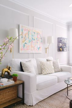 Classy modern white sofa: http://www.stylemepretty.com/living/2016/08/09/25-white-hot-sofas-that-totally-steal-the-show/