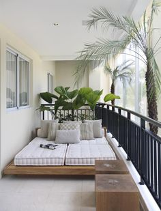 This is an interesting balcony. It seems to be enclosed in a type of atrium. On the outside there are no buildings there just trees and open areas. PK.