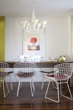 Mixing styles--rustic dining table and modern chairs