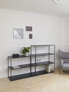 The two-tone reversible shelves of the Twin Bookcase encourage individuality and…