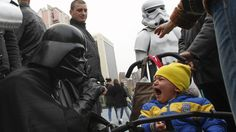 """AUTHORIZED.  Darth Vader, the official candidate of the Ukrainian Party of the internet continues his campaign this Wednesday, Oct. 22 in Kiev, Ukraine for the parliamentary elections next Sunday.  His party has submitted a list of 17 candidates, all of whom changed their name to that of a character from the famous saga """"Star Wars.""""  They hope that the force will be with them."""
