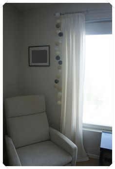 Light balls in window, from happylights.be