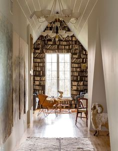 The book shelf around the window is such an awesome idea, especially if you have a drop curtain at night instead of side curtains!