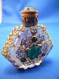 Vintage CZECH. mini perfume bottle wmetal filigree and glass jewels (marked)