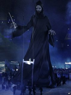 A giant figure stands out during the opening ceremony at the 2012 Summer Olympics
