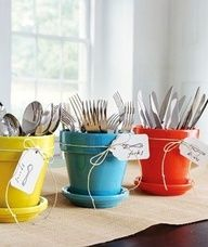Spray paint some pots to hold silverware - genius!
