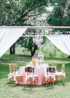 Pin for Later: 10 Creative Outdoor Wedding Ideas You'll Want at Your Reception Go With Unexpected Decor Like a chandelier above the outdoor tables — so chic and different!