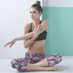 Stretch out in a black sports bra and printed capri leggings.