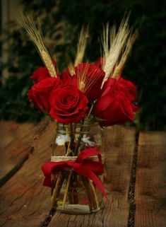 Red and black centerpieces with mason jars | Wedding Centerpieces Red Roses, Mason Jars, and Wheat. Country Wedding ...