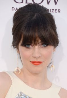 Zooey Deschanel does a coral lip