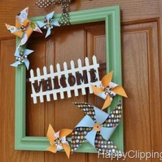I've gotten on board with the yarn wreaths, but I never thought to use an old frame. How adorable! Though I'm not sure how I feel about the pinwheels, I'm loving this idea. Think I'll have to try this one!