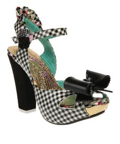 """How better to take down the dance floor than in fiercely fashionable footwear? Frills, gingham and bows only add to this pair's quirky appeal, while a chunky heel offers standout style.5"""" heel with 1"""" platformSnap closureFabric / leather upperMan-made sole"""