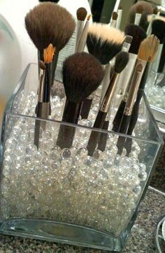 Here is an easy project for this weekend. Organize your makeup brushes in a vase or other tall clear container and fill with marbles or sand to stand brushes up.