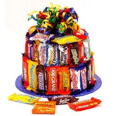 It's a cake! It's a candy gift! It's a fun cake! This festive candy bar cake is a welcome delivery whenever it's sent. Perfect for birthdays, graduations or to congratulate someone for any special event