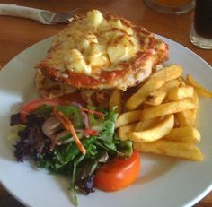 A quality Chicken Parma, Chips and Salad!