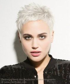 Very short pixie for platinum blonde hair. Cute short haircut for fashion minded women.