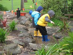 A creek meanders through the play area linking the rainwater tank, the sandpit and the frog pond