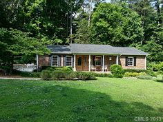 1058 Sheraton Way, Rock Hill, SC 29732 - MLS/Listing # 2163318. Listed for $169,900. This full-brick ranch features an open living, kitchen & dining room floor plan with hardwood flooring throughout most of the house. The totally renovated kitchen features custom cabinetry, glass cabinet doors, gas range, granite counters & pendant lighting. Unexpectedly large bedrooms. Master suite w/ walk-in closet off bath. Tankless water heater. Shed & workshop. Firepit. Call 704-918-1815 for a showing…