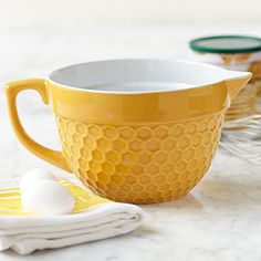 Batter Bowl Honeycomb Yellow  A new classic made especially for Stonewall Kitchen.  Each batter bowl features a handle for easy gripping, a spout for easy pouring and is just the right size to mix up a batch of muffin batter or pancake batter. Keep the counter cleaner by pouring batter from the spout and, of course the bowls are dishwasher safe. Each has a 7 cup capacity. $24.95