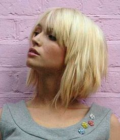 Short layered bob with bangs. Looks like its shorter at the back.