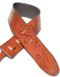 A fun one of a kind guitar strap! Hand tooled musical notes and stars all leather tooled by Vicki Charles. A great gift for a guitar, bass or mandolin player. VickiDesignsCA
