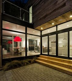 This contemporary house design features spacious and calming living spaces. Designed by Canadian architect Christopher Simmonds, the Zen Barn is a contemporary home located in Ottawa, Canada. contemporary home zen barn with modern interiors in neutral colors with red lamp shades