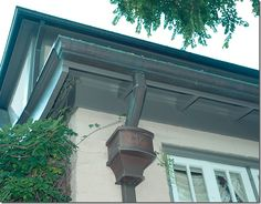 patina covered copper drains and gutters Exterior Paint, Exterior Design, Dream Garden, Home And Garden, Leaf Guard, Copper House, Seamless Gutters, Copper Gutters, Front Door Porch