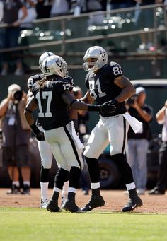 Mychal Rivera #81 of the Oakland Raiders is congratulated by Denarius Moore #17 of the Oakland Raiders after he scored a touchdown against the Washington Redskins at O.co Coliseum on September 29, 2013 in Oakland, California.