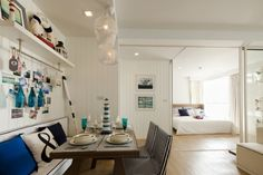 The beach theme continues in the interior design of the apartments, with nautical memorabilia scattered over walls and display shelves, and the same blue and white color scheme we see begin at the sales office.