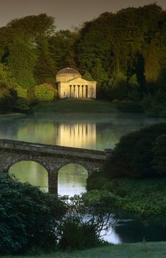 The Pantheon reflected in the lake at Stourhead, Wiltshire, UK with the Palladian bridge in the foreground
