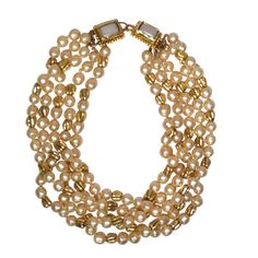1980s Chanel 5-Strand Faux Pearl Baroque Necklace | From a unique collection of vintage beaded necklaces at http://www.1stdibs.com/jewelry/necklaces/beaded-necklaces/