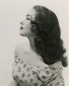 long hair 1940s; the horseshoe or long middy cut. classic make-up, arched brows, lashes and lips with luminous, matt complexion.