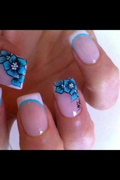 A funky french manicure twist with blue floral design and trim .Nails