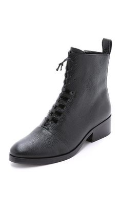 Pebbled leather 3.1 Phillip Lim combat boots, accented with lace-up detailing and outfitted with a hidden side zip. - 3.1 Phillip Lim Alexa Lace Up Boots