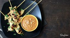 Chicken satay with spicy peanut dipping sauce  Stick Together via @PureWow via @PureWow