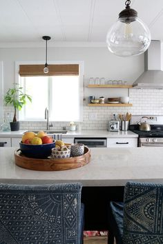 """Nona's kitchen: FULL REVEAL: """" I used a pretty pale gray for the walls. It's called """"Summer Gray"""" from Valspar in a flat finish and then we painted all the trim """"Ultra White"""" in semi-gloss which was also by Valspar."""""""