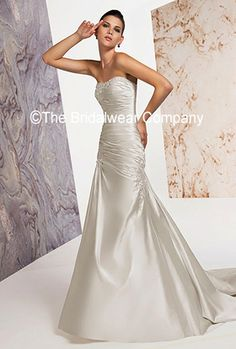 Cayla by Claudine for Alyce Designs, is a figure hugging wedding dress that has a timeless elegance about it.    This fitted, Satin strapless wedding dress with sweetheart neckline, has pretty beading on the pleated bodice, and decorated with more applique.