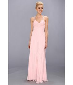 Turn heads and melt hearts in this captivating Faviana™ gown.. Glamorous poly chiffon dress featur...