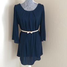 1 Hour Sale Cutout Tunic / Dress NWOT This chic and minimalistic tunic dress features a cutout back, three quarter sleeves, and an adorable ivory bow belt (which can be worn with any outfit to add some charm). Wear this as a dress or with leggings. New without tags boutique . 100% polyester, semi-sheer. ⚡️Price Firm Dresses