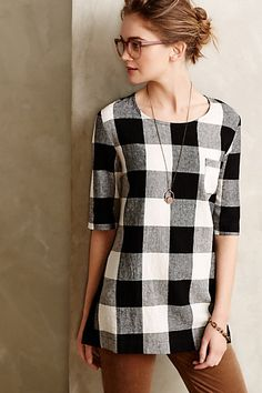 Newsprint Plaid Tunic in black and white buffalo plaid (anthropologie.com)