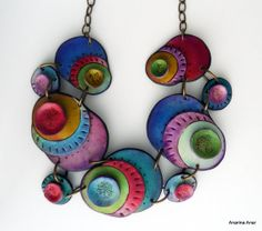Anarina Anar's Polymer clay necklace. $121.00 - Unique organic shape. - Total length: 26cm - The ring through which the T-bar is secured, is on the right side of the necklace.