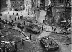 "On 8 May 1945 the SS had been given a ""safe passage"" clearance and a route to exit the Prague city limits; this is a snapshot of an armored W-SS column passing through the previously destroyed Old-Town square. German Soldier, Old Town Square, Story Of The World, Total War, Cabriolet, Military Photos, Red Army, World War Two, Europe"