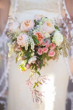 This bouquet cascades with vintage and romantic inspired flowers | Anne Griggs | Millie Holloman #weddings #bouquets