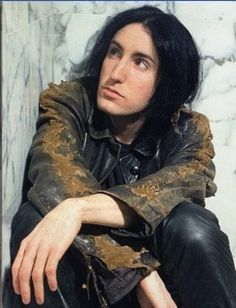 Trent Reznor.You either love or hate his music...Or if your me you kinda love his music more by the second:)