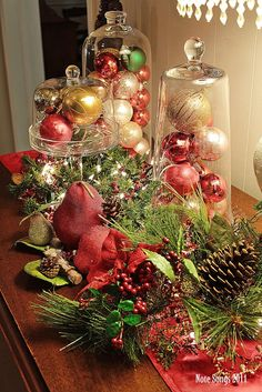 Accessories Decorating. Appealing Christmas Table Centerpiece Design Inspirations. Fetching Christmas Table Centerpiece Decoration Come With Contemporary Clear Glass Jar With Assorted Colour Christmas Ball Candy And Green And Red Pear Fruit Plus Pine Cone Together With Red Table Runner And Also Green Leaf Christmas Centerpiece Plus Wooden Table. Christmas Table Centerpiece