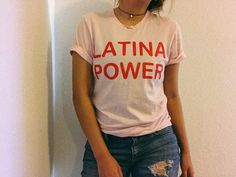 Latina and proud because Latinas are fierce and strong. Show your pride with the perfect tee. $1 from each sale will be donate to ACLU - Soft Pink tee/ red design - Unisex Fit - Screenprinted in Brown